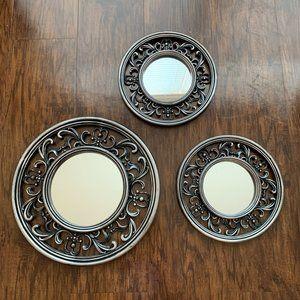 set of three metallic lightweight wall mirrors